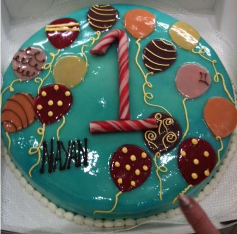 taart rond met ballonnen